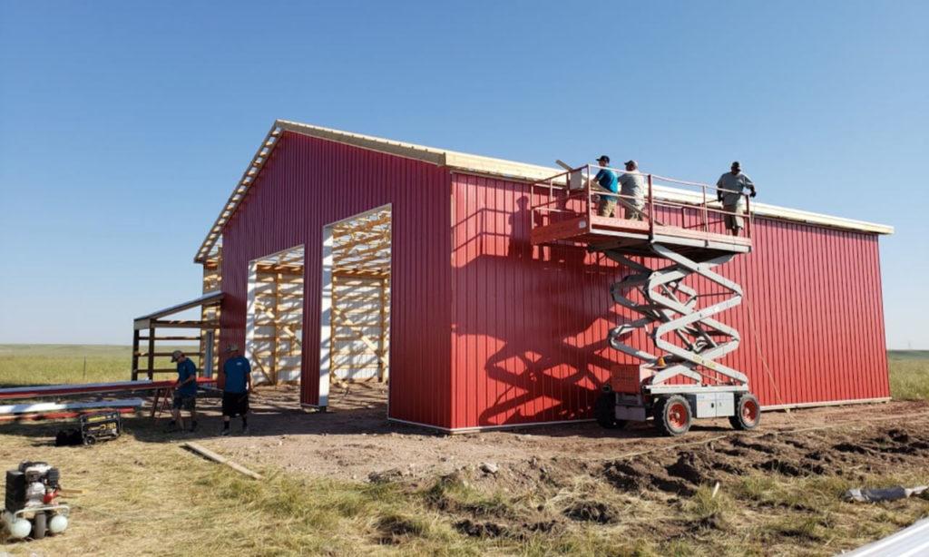 Big D's Fencing & Pole Barns constructing a pole barn in Cheyenne, WY